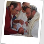 A father receives his son in preparation for the bris